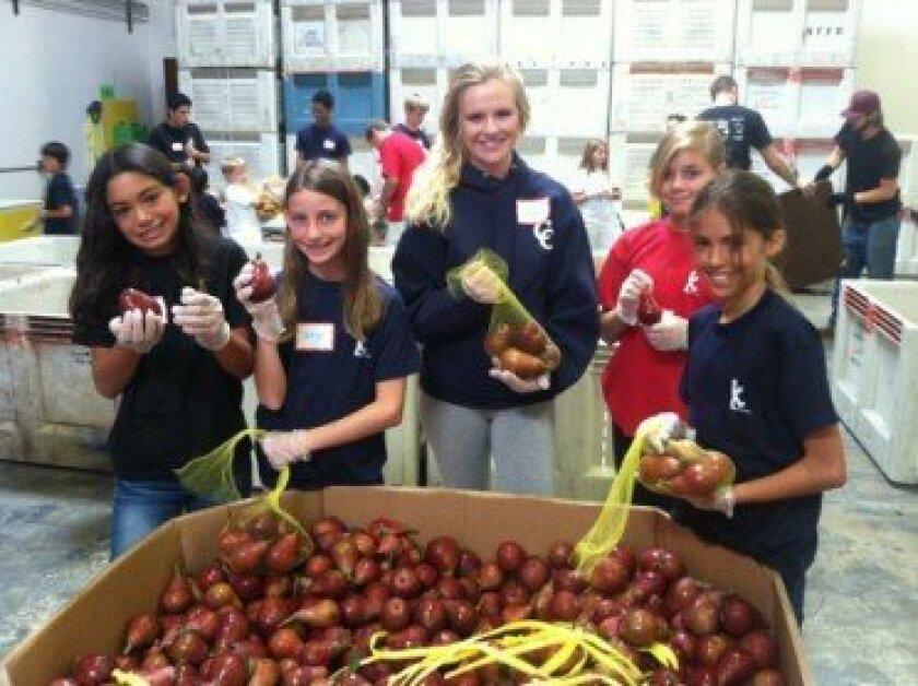 Bagging fruit at the San Diego Food Bank