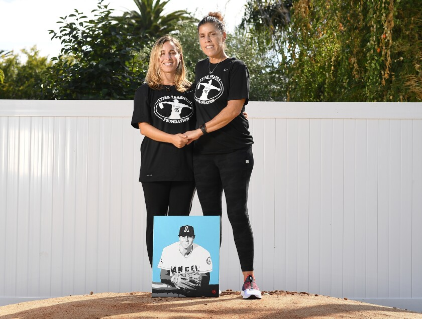 Tyler Skaggs wife, Carli Skaggs and his mother Debbie stand on a pitchers mound in the backyard of the home he grew up in.