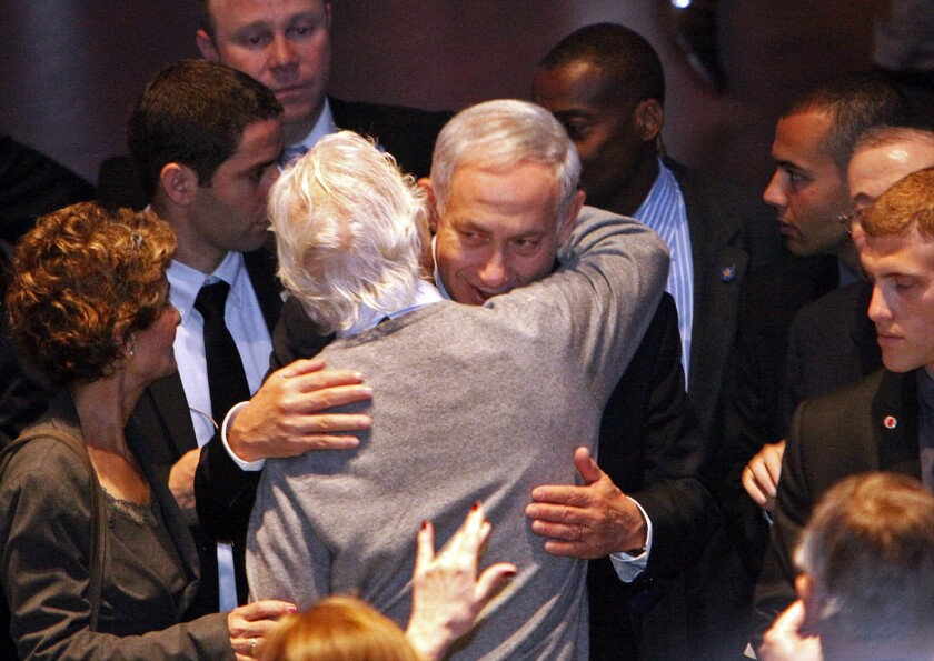 """Israeli Prime Minister Benjamin Netanyahu embraces a friend after speaking at the Museum of Tolerance in Los Angeles. In his speech, Netanyahu said anti-Jewish rhetoric in Iran could have dire consequences: """"When someone says they're going to annihilate you, take them seriously."""""""