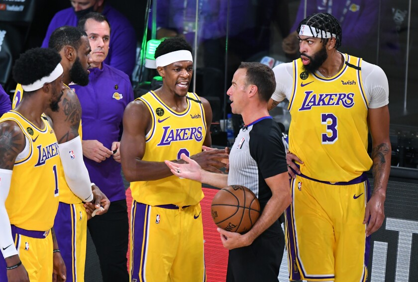 Lakers guard Rajon Rondo (9) has a few words for an official during Game 1 of the NBA Finals.