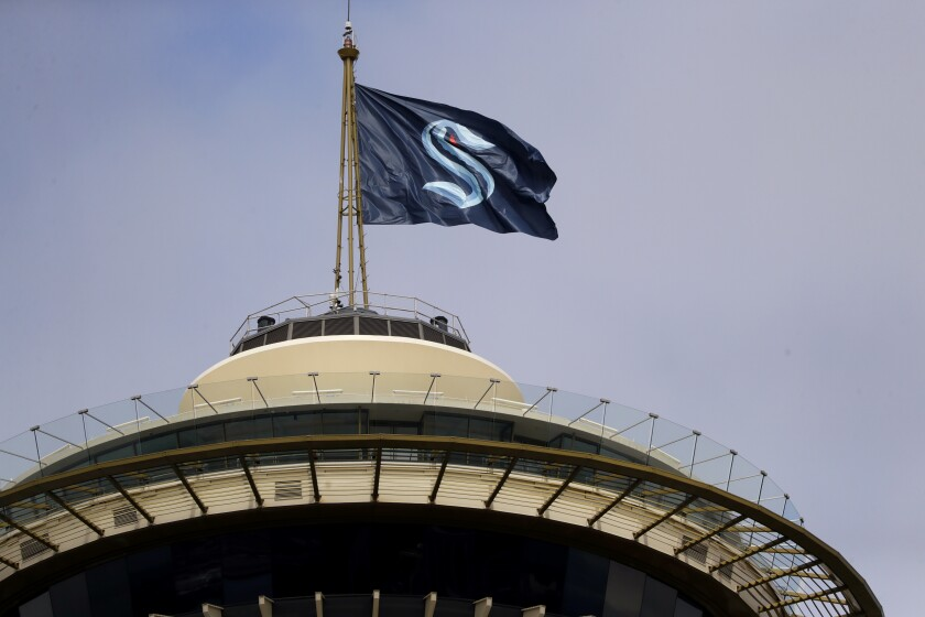 A flag with the logo of the Seattle Kraken flies atop the iconic Space Needle on July 23.