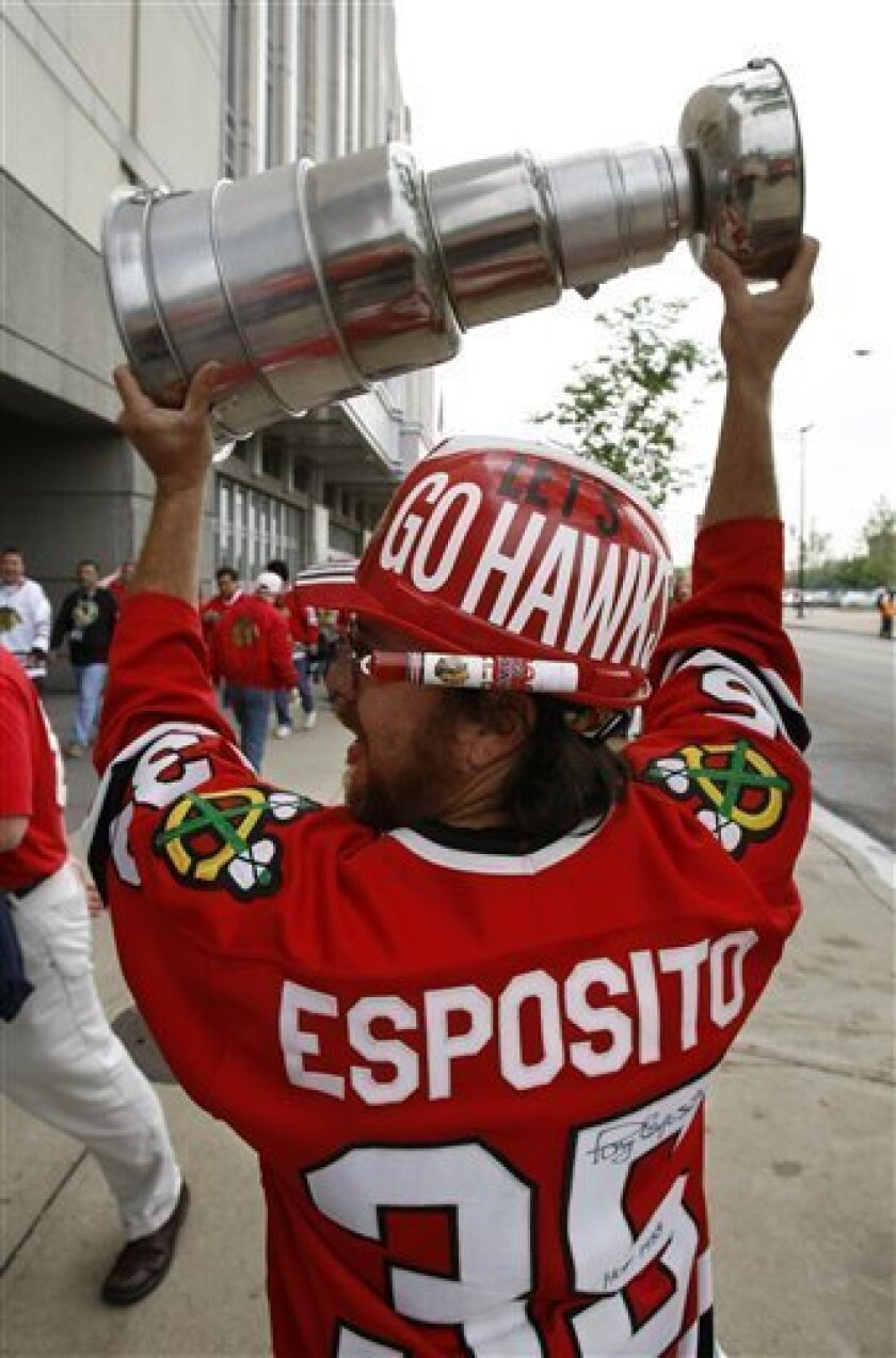 Ray Alcala carries his own Stanley Cup in front of the United Center before the start of Game 2 of the Stanley Cup hockey finals between the Blackhawks and Philadelphia Flyers on Monday, May 31, 2010, in Chicago. (AP Photo/Charles Rex Arbogast)