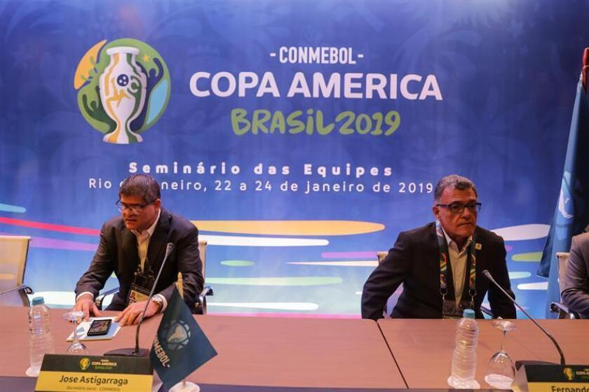The general secretary of the Conmebol, José Astigarraga (left), and the president of the Organizing Council of the Copa América 2019, Fernando Sarney (right), participate in a seminar about the tournament in the city of Rio de Janeiro, Brazil Jan, 22, 2019 EPA-EFE/ Antonio Lacerda
