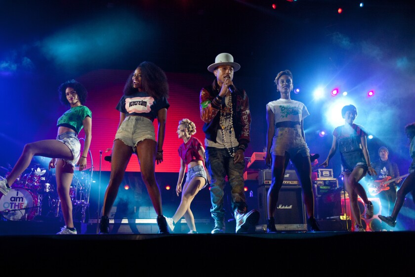 Pharrell Williams performs on the Camp Stage during Odd Future's third annual Camp Flog Gnaw carnival at the park outside of Los Angeles Memorial Coliseum on Saturday, Nov. 8, 2014.