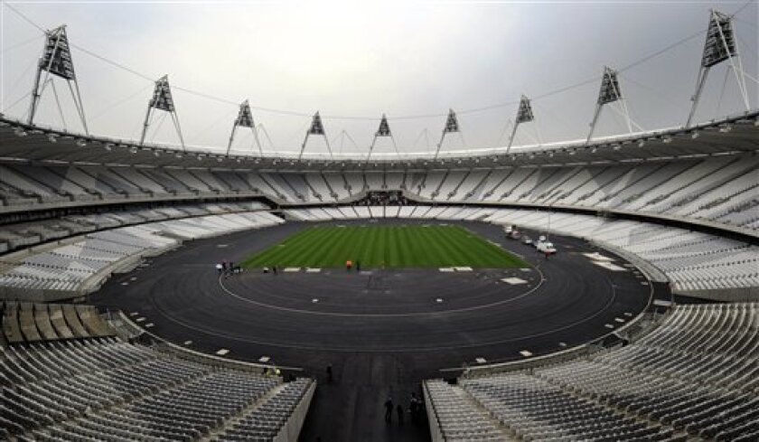 FILE - In this March 29, 2011 file photo, a view of the London 2012 Olympic stadium, in London. The IOC wants London organizers to make sure the opening ceremony of next year's Olympics finishes by midnight so athletes can return to the village at a reasonable hour. (AP Photo/Tom Hevezi, File)