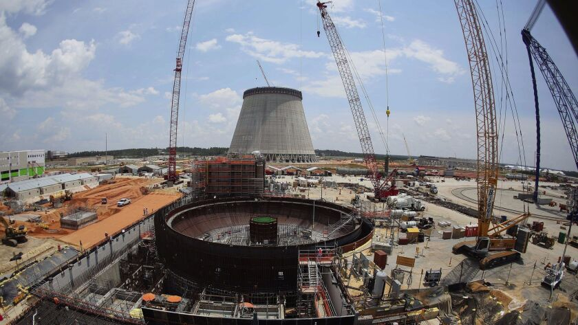 FILE- In this June 13, 2014, file photo, construction continues on a new nuclear reactor at Plant Vo