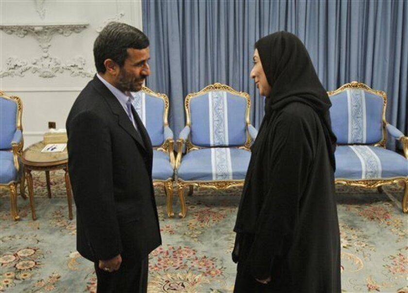Iranian President Mahmoud Ahmadinejad, left, welcomes speaker of Pakistan parliament's lower house Fehmida Mirza, at the presidency in Tehran, Iran, Thursday, Feb. 4, 2010. (AP Photo/Vahid Salemi)