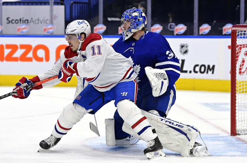 Toronto Maple Leafs goaltender Frederik Andersen (31) looks for the puck as Montreal Canadiens right wing Brendan Gallagher (11) blocks his view during the first period of an NHL hockey game in Toronto on Saturday, Feb. 13, 2021. (Frank Gunn/The Canadian Press via AP)