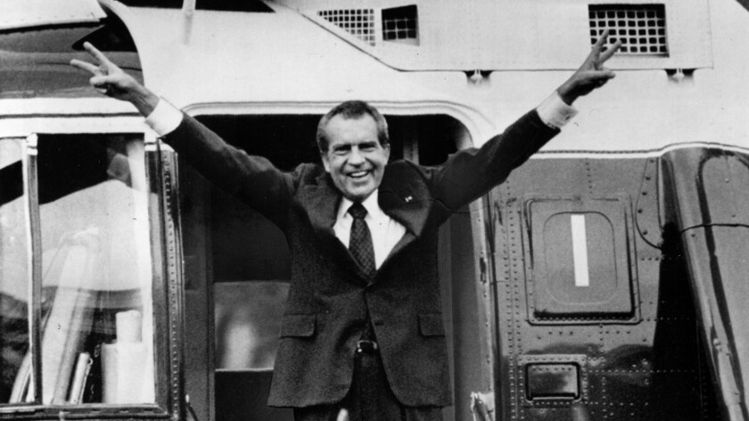 Aug. 9, 1974: President Nixon boards a helicopter on the White House grounds after submitting his resignation as the nation's chief executive.