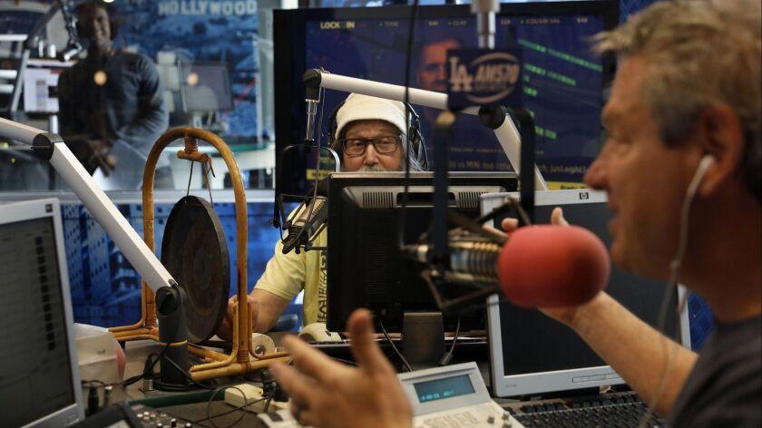 "BURBANK, CA-NOVEMBER 29, 2018: Radio sports announcer Vic ""The Brick"" Jacobs, center, participates"