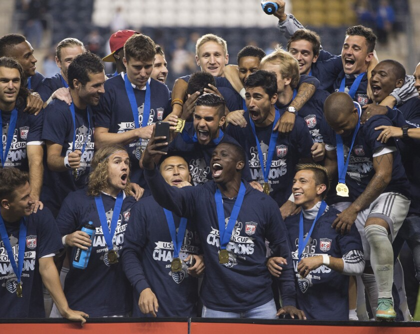 Sporting Kansas City takes a team photo after defeating the Philadelphia Union in the U.S. Open Cup Final.