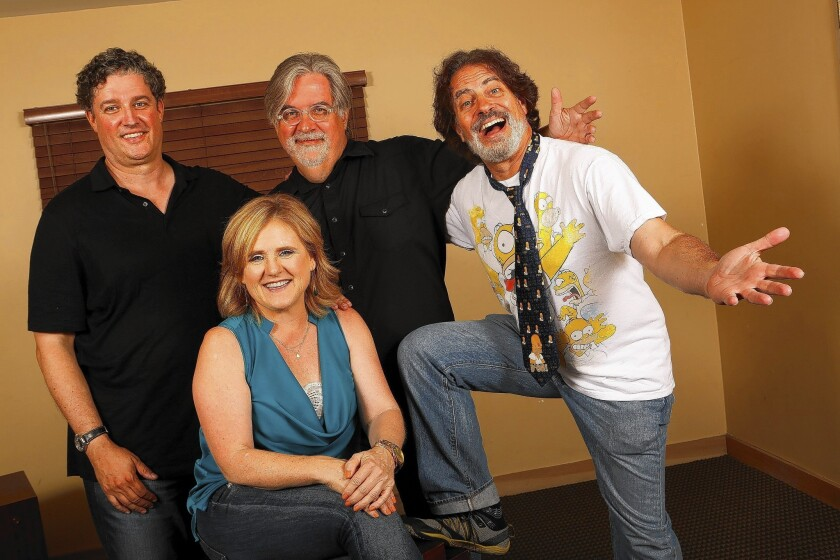 """Director David Silverman, right, voice of Bart Simpson Nancy Cartwright, front, producer Al Jean, left, and creator Matt Groening of """"The Simpsons"""" at Fox Studios in Los Angeles."""