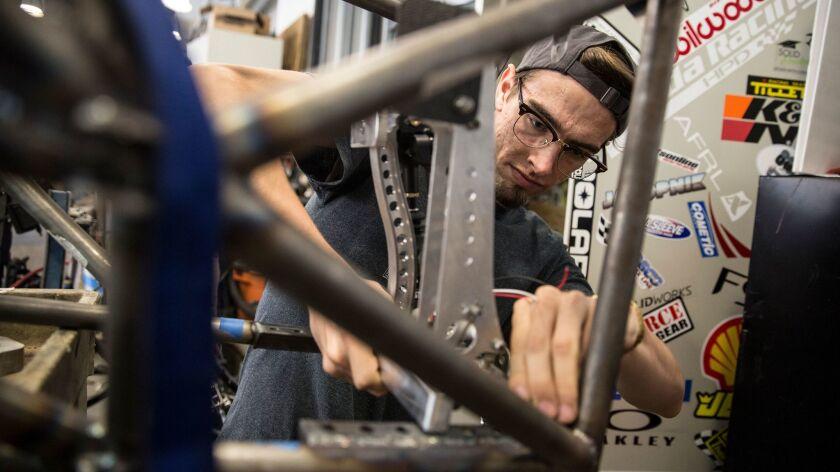 UCLA student Owen Hemminger works on UCLA Formula SAE team's car on the Westwood campus workshop.