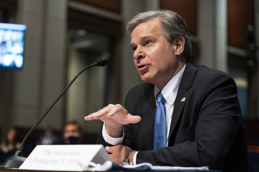 """FILE - In this Thursday, June 10, 2021, file photo, FBI Director Christopher Wray testifies before the House Judiciary Committee oversight hearing on the Federal Bureau of Investigation on Capitol Hill, in Washington. The FBI says it is getting serious about sexual harassment in its ranks, starting a 24/7 tip line, doing more to help accusers and taking a tougher stand against agents found to have committed misconduct. """"There is nothing more important than our people and how we treat each other,"""" Wray said. """"I have tried to make it crystal clear that we're going to have zero tolerance for that kind of activity at any level within the organization."""" (AP Photo/Manuel Balce Ceneta, File)"""