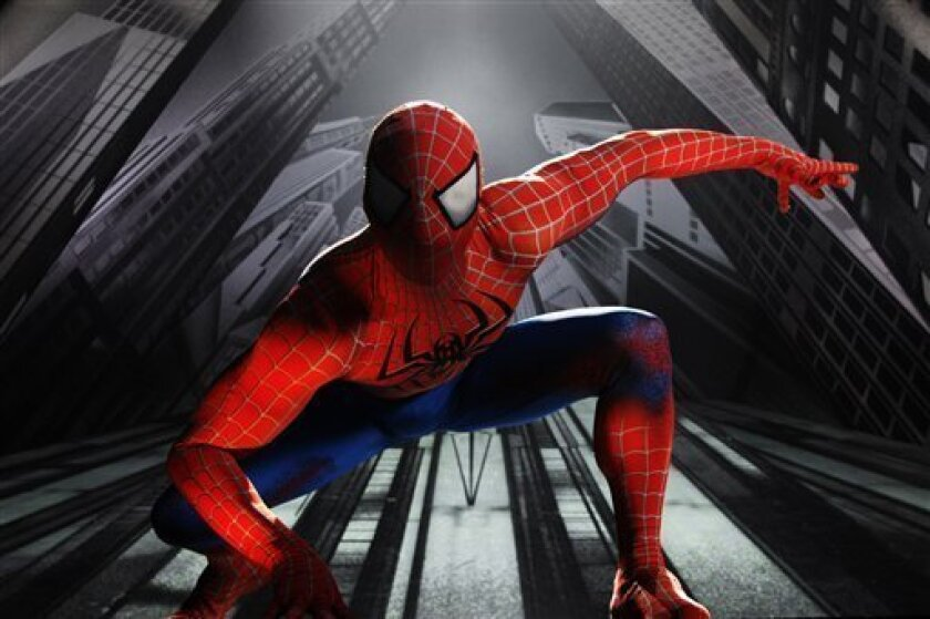 """In this theater publicity image released by The O and M Co., Christopher Tierney portrays Spider-Man in the musical """"Spider-Man: Turn Off the Dark,"""" in New York. (AP Photo/The O and M Co., Jacob Cohl) NO SALES"""