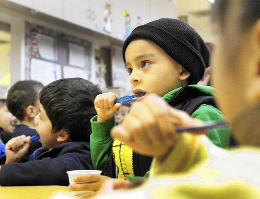 Derick Arciniega, 4, brushes his teeth at PACE Early Childhood Education program in Los Angeles. Gov. Jerry Brown and state legislators are negotiating more budget funds for preschools.