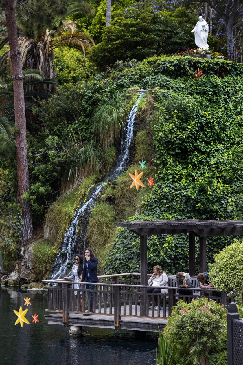 Visitors enjoy the Meditation Gardens at the Self-Realization Fellowship Lake Shrine in Pacific Palisades.