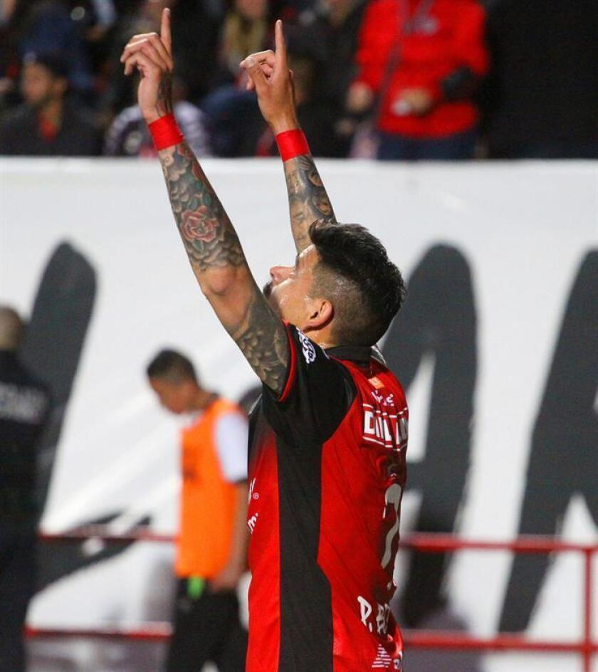 El jugador de Xolos Gustavo Bou festeja una anotación ante Toluca. EFE/Archivo