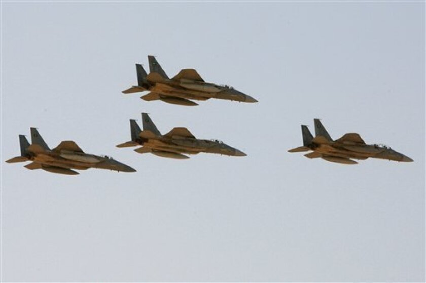 In this photo taken Sunday, Jan. 25, 2009, F-15 warplanes of the Saudi Air Force fly over the Saudi Arabian capital Riyadh during a graduation ceremony at King Faisal Air Force University. According to Arab diplomats speaking on condition of anonymity, Saudi Arabian Tornado and F-15 warplanes have bombarded targets inside Yemen since Wednesday afternoon, inflicting significant casualties on the Yemeni Shiite rebels. (AP Photo/Hassan Ammar)