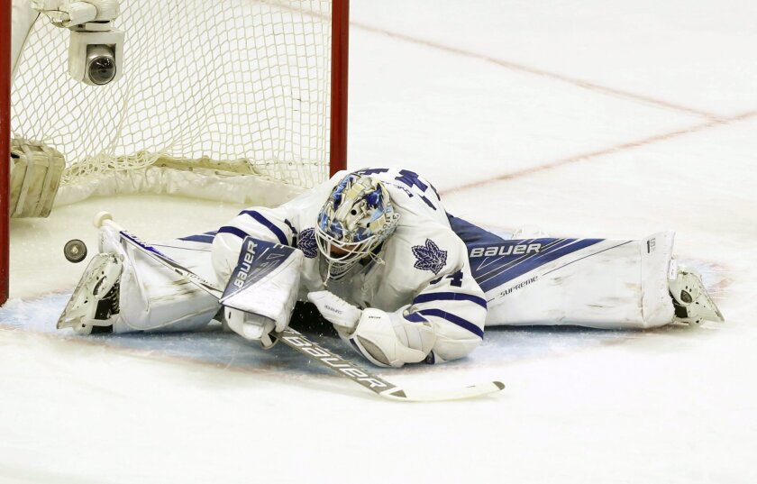 Toronto Maple Leafs' goalie James Reimer (34) watches the puck go past him on a goal by Ottawa Senators' Mika Zibanejad, not shown, during the first period of an NHL hockey game, Saturday, Feb. 6, 2016, in Ottawa, Ontario. (Fred Chartrand/The Canadian Press via AP) MANDATORY CREDIT
