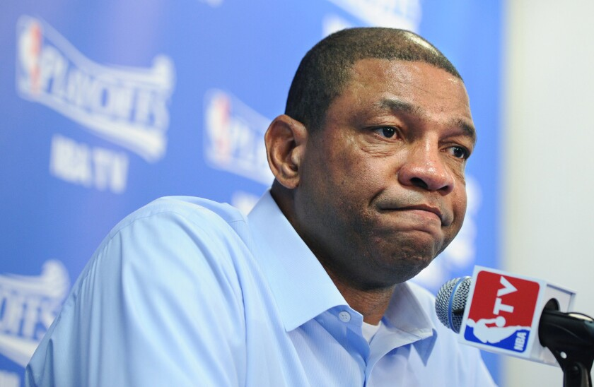 Clippers coach Doc Rivers speaks at a press conference.