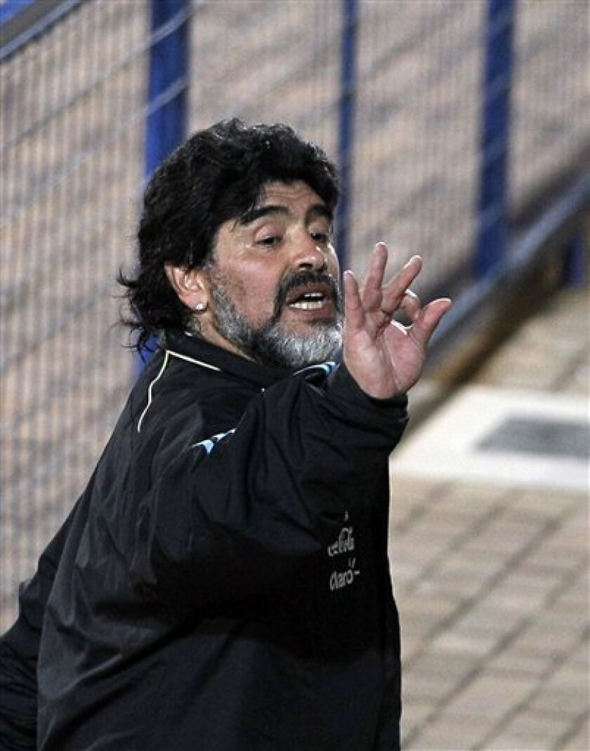 Argentina's soccer team coach Diego Maradona gestures as he leaves the field at the end of a practice session in Pretoria, South Africa, Wednesday, June 9, 2010. Argentina will play in the Group B of the soccer World Cup, set to kick off on June 11. (AP Photo/Ricardo Mazalan)