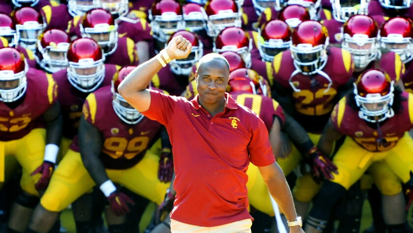 Lynn Swann prepares to lead the USC football team onto the field at the Coliseum for a game in 2014.