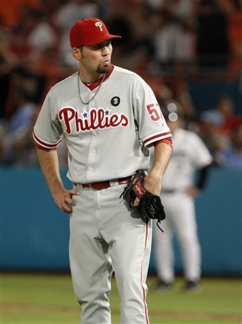 Philadelphia Phillies relief pitcher David Herndon reacts after Florida Marlins' Gaby Sanchez hit a three-run home run in the eighth inning during a baseball game in Miami, Saturday, Sept. 3, 2011. The Marlins hit three home runs off Herndon in the eighth inning. (AP Photo/Lynne Sladky)