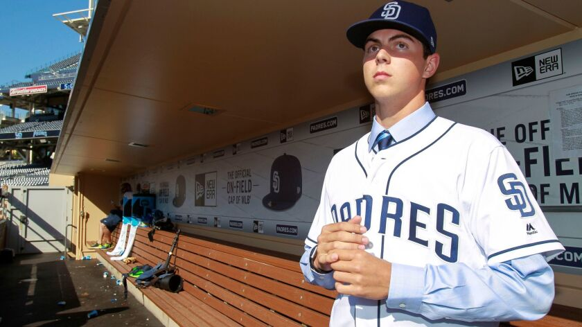 MacKenzie Gore, the Padres' first-round pick, stands in the Petco Park dugout in June.