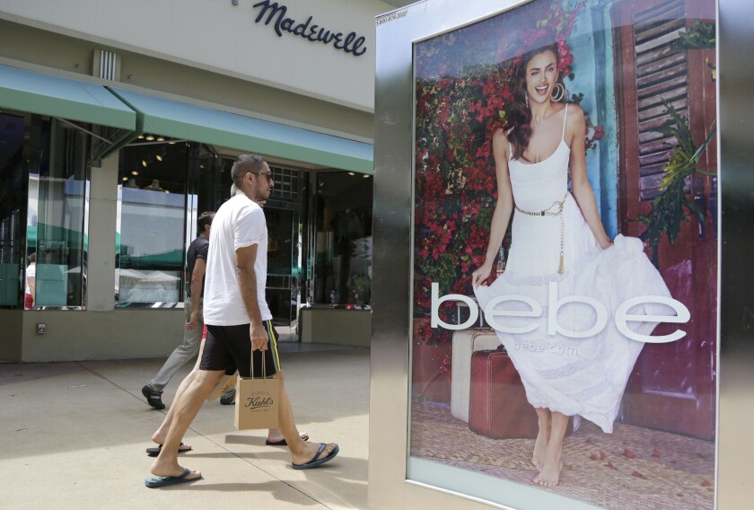 Shoppers walk along Lincoln Road Mall, a pedestrian street featuring stores and outdoor cafes, in Miami Beach, on March 13.