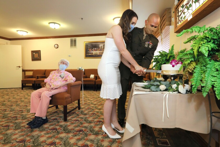 Amber Cross and Daniel Jackson cut their wedding cake after getting married in Escondido.