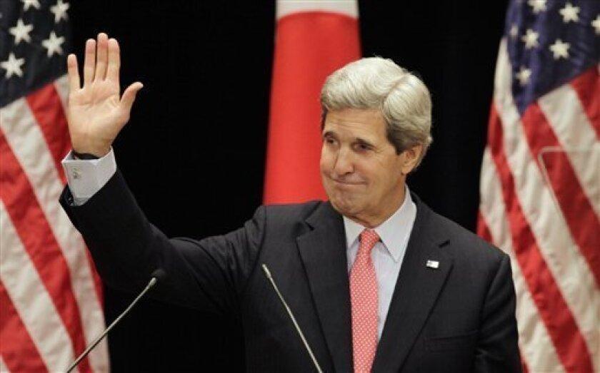 U.S. Secretary of State John Kerry waves after his lecture to students at Tokyo Institute of Technology in Tokyo Monday, April 15, 2013. Kerry is here as part of Asian tour amid a tense situation over a possible missile launch by North Korea. (AP Photo/Junji Kurokawa, Pool)