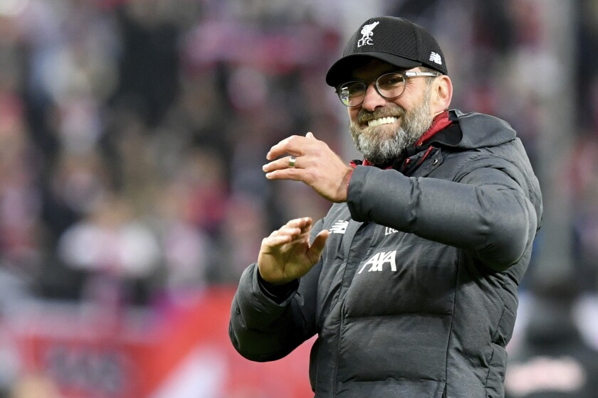 Liverpool's manager Jurgen Klopp celebrates at the end of the group E Champions League soccer match between Salzburg and Liverpool, in Salzburg, Austria, Tuesday, Dec. 10, 2019. Liverpool won 2:0. (AP Photo/Kerstin Joensson)