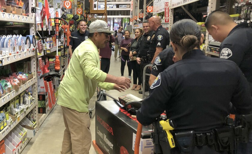 Seven Santa Ana Police officers took Adrian Salgado to Home Depot to buy him new gardening equipment