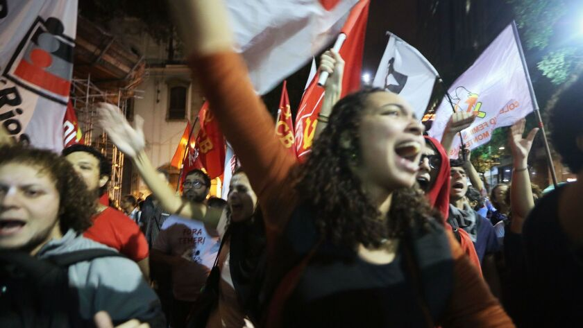 Demonstrators protest May 18 in Rio de Janeiro in the aftermath of a recording allegedly revealing