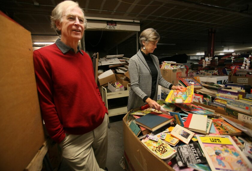 Mike and Terry Meaney sort books in the San Diego Book Project's East Village warehouse.