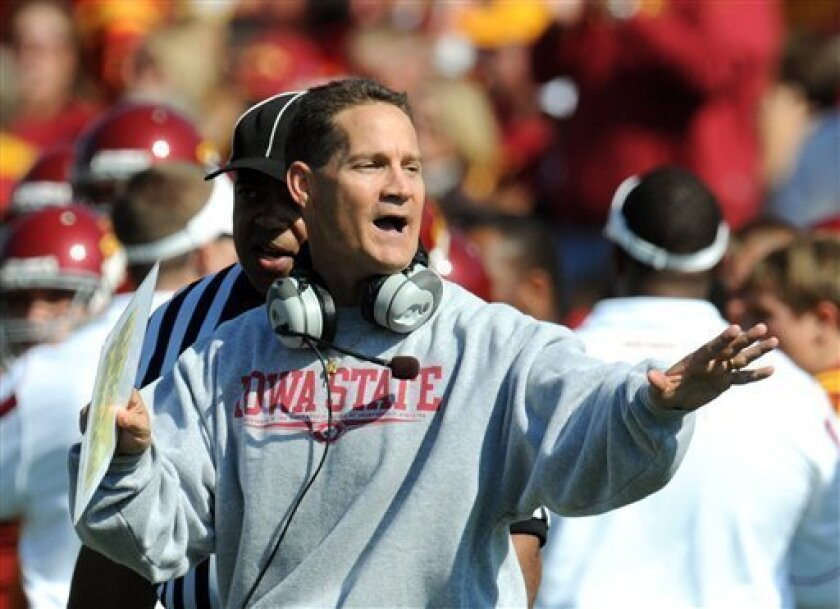 In this Oct. 4, 2008 file photo, Iowa State's head coach Gene Chizik reacts to a play against Kansas during the second half of an NCAA college football game in Ames, Iowa. Kansas beat Iowa State 35-33. Auburn has reportedly hired Iowa State's Chizik as its new football coach, turning to a former defensive coordinator who helped the Tigers forge a perfect season but has won five games in two years as a head coach. The Birmingham News, Mobile Press-Register, Rivals.com and Cedar Rapids Gazette reported Saturday Dec. 13, 2008, that the former Auburn defensive coordinator will succeed Tommy Tuberville, who resigned following 10 seasons with an 85-40 record. (AP Photo/Steve Pope, File)