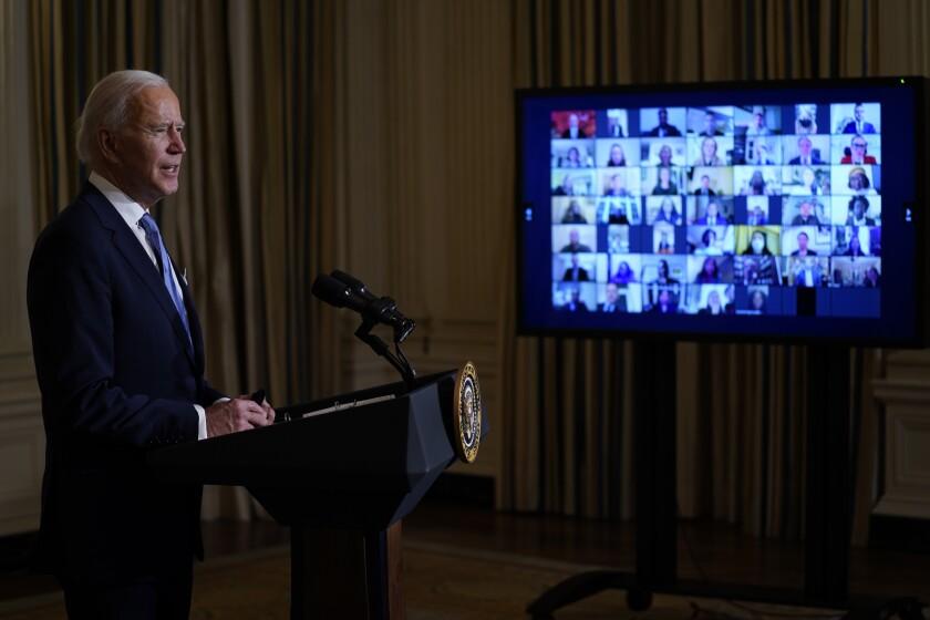 President Joe Biden speaks during a virtual swearing in ceremony of political appointees.