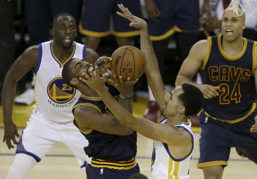 Cleveland Cavaliers guard Kyrie Irving, center left, shoots against Golden State Warriors guard Shaun Livingston during the first half of Game 2 of basketball's NBA Finals in Oakland, Calif., Sunday, June 5, 2016. (AP Photo/Ben Margot)