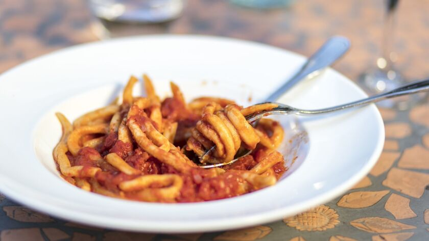 LOS ANGELES, CALIFORNIA - June 4, 2019: A plate of pici all'aglione, a hand-rolled pasta with a gar
