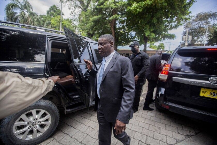 Haiti's newly-named Justice Minister Liszt Quitel, leaves after he was installed in office, in Port-au-Prince, Haiti, Thursday, Sept. 16, 2021. (AP Photo/Richard Pierrin)