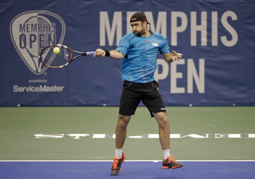 Benjamin Becker, of Germany, returns a shot to Taylor Fritz in a quarterfinal at the Memphis Open tennis tournament Friday, Feb. 12, 2016, in Memphis, Tenn. (AP Photo/Mark Humphrey)