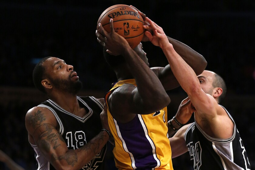 LOS ANGELES , CA. -- FRIDAY, JANUARY 22, 2016 -- Brandon Bass, of the Los Angeles Lakers, is closel