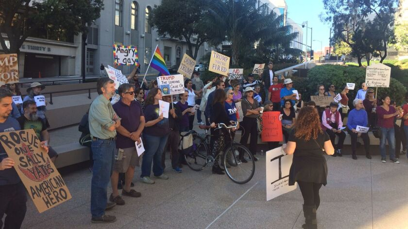 """Around 60 protesters for """"Resist Trump Tuesdays"""" outside the building, which houses the San Diego office of U.S. Sen. Kamala Harris."""