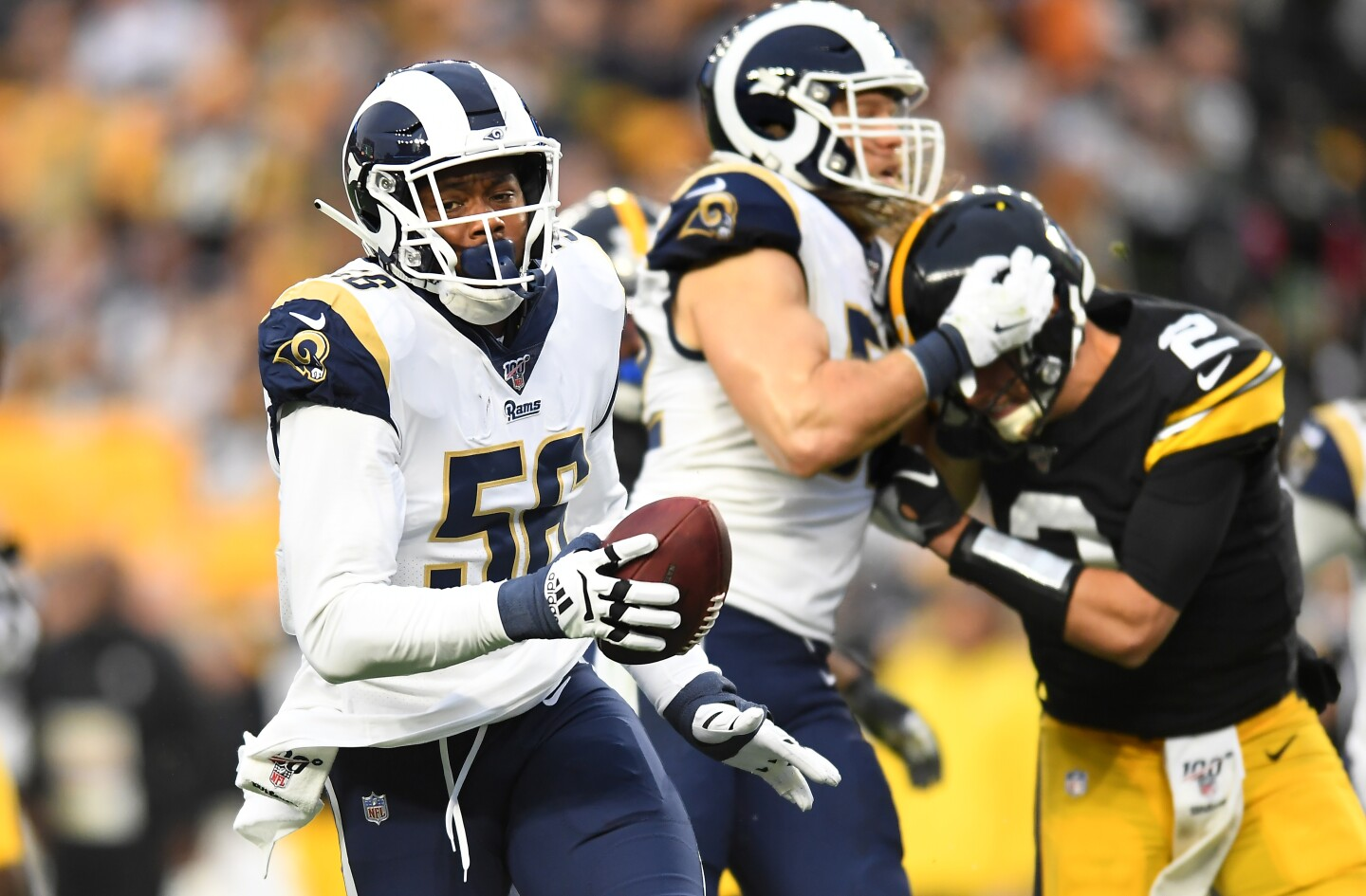 PITTSBURGH, PENNSYLVANIA NOVEMBER 10, 2019-Rams linebacker Dante Fowler Jr. returns a fumble for a touchdown as Steelers quarterback Mason Rudolph is handled by Clay Matthews at Heinz Field in Pittsburgh Sunday. (Wally Skalij/Los Angerles Times)