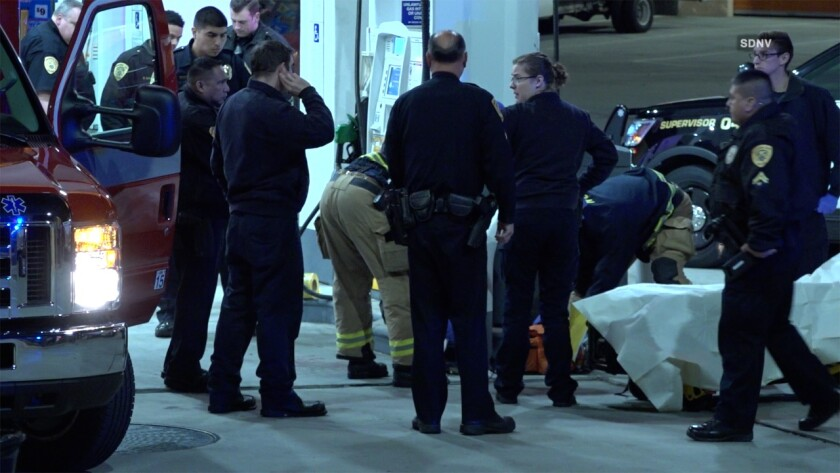 Paramedics transported two people to the hospital after they showed up with gunshot wounds at a gas station in National City early Tuesday.