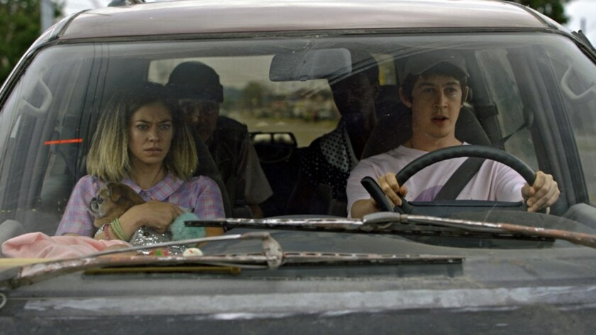 "Analeigh Tipton, from left, Jeremy Irons, Edi Gathegi and Alex Sharp in the movie ""Better Start Running."""