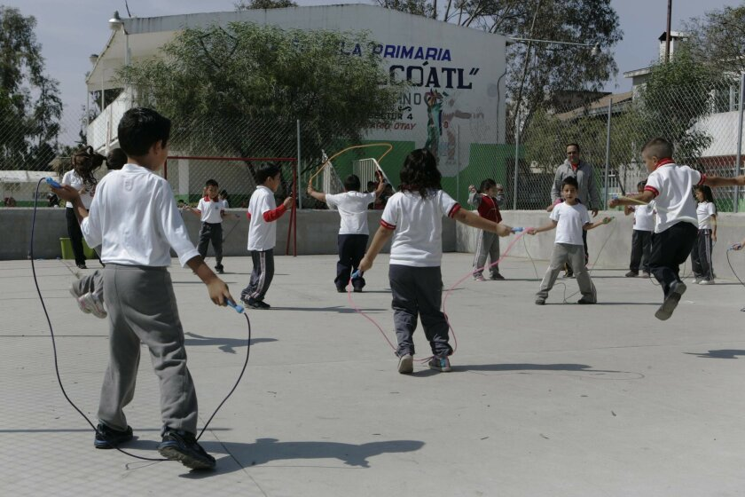 Children at Tijuana's  Moctezuma Xocoyotzin Elementary School face off in a jump rope competition as part of a program sponsored by the Hospital Infantil de las Californias that encourages exercise and nutrition.