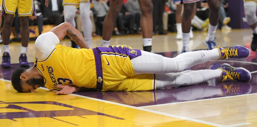 Anthony Davis winces after taking a hard fall against the New York Knicks on Jan. 7 at Staples Center.