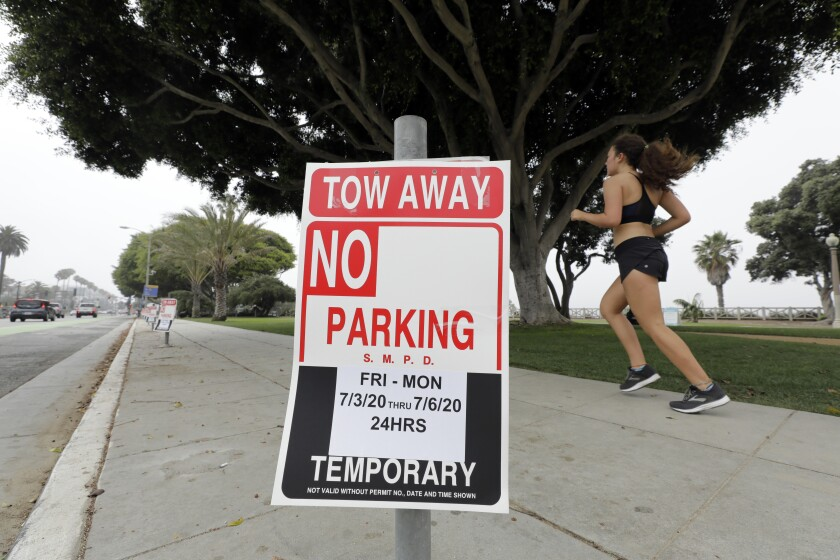 No parking signs from the Fourth of July weekend still block spots on Ocean Avenue in Santa Monica on Monday.
